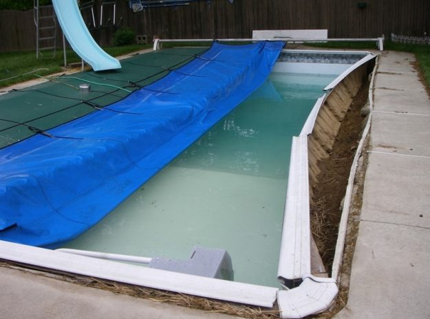 Pool walls buckle inward from ground pressure. Photo credit: APCO Pool Specialties
