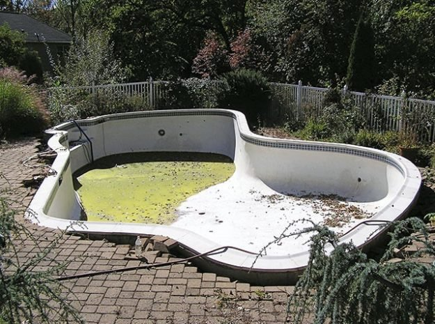 Swimming pool pushed upward while empty. Photo Credit: Pool Water Recycling
